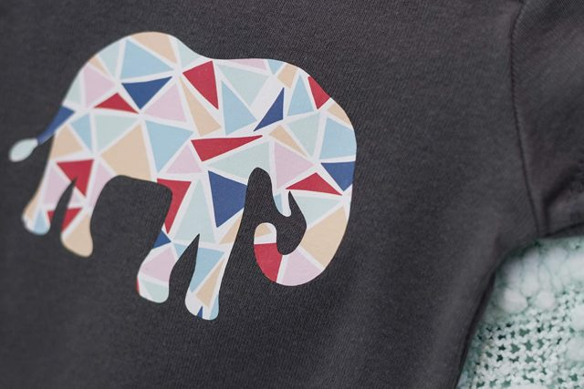 Iron on Paper Packs elephant design on gray shirt.