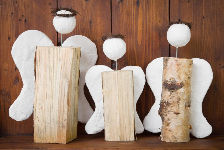 Three angel hand made of wood for christmas - rustic handicraft in country style