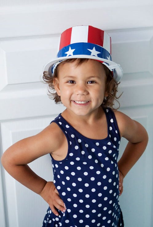 little girl smiling wearing DIY DUCT TAPE UNCLE SAM HAT