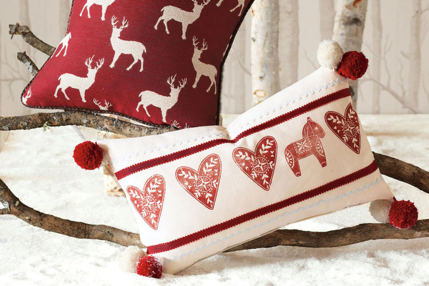 Two christmas pillows, twigs in white background