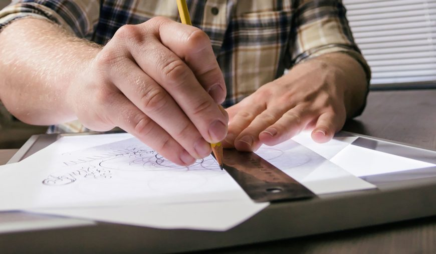 man using ruler and pencil