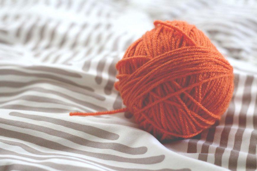 Orange ball winders on cloth