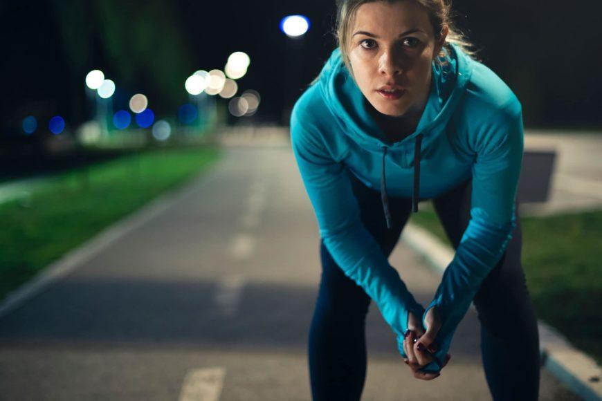 Woman in jogging attire squating