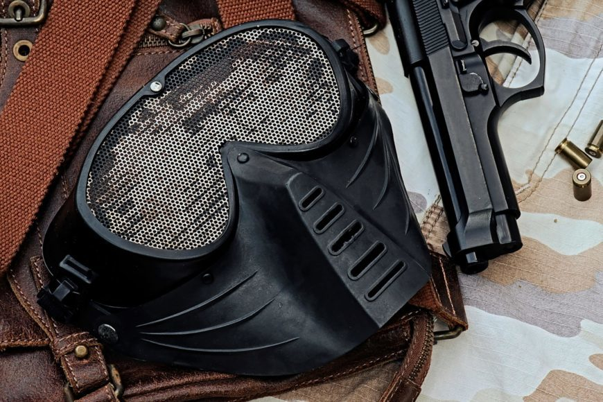 Close up shot of Airsoft masks cover and gun