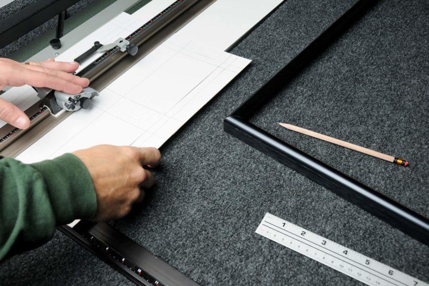 Man using mat cutter