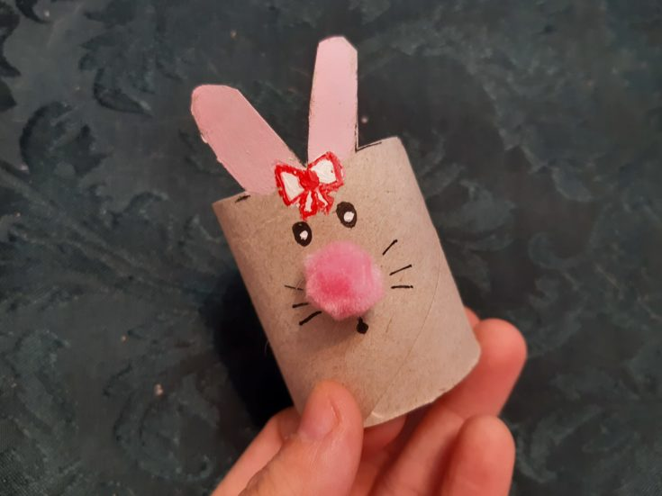 Cardboard tube bunny with glued pink pom pom nose.