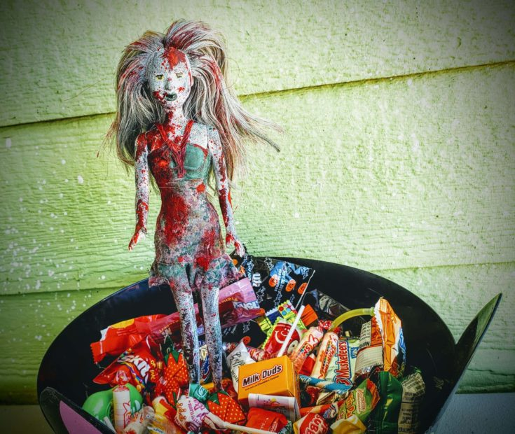 Barbie zombie decorated on top of tub candy treats.