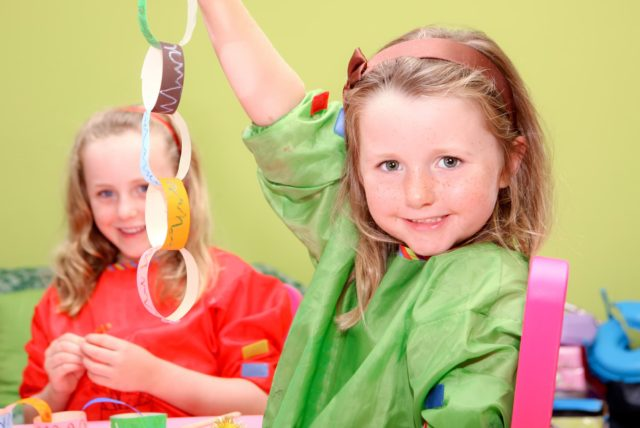 happy children or kids playing art and craft