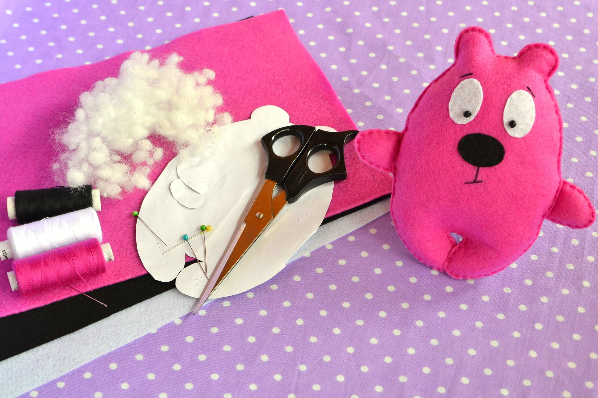Pink felt Teddy bear, handmade toy. Scissors, needle, thread, pins, paper templates - sewing kit