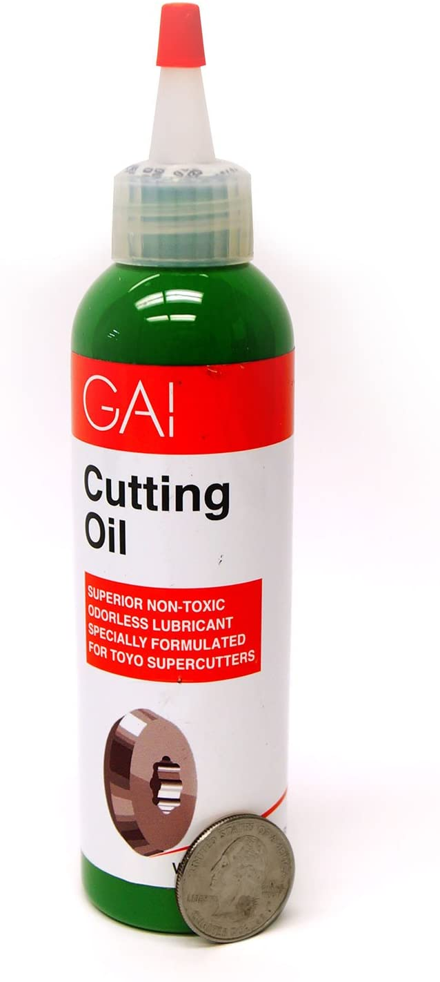 Gai Cutting Oil - 4 Oz with a coin on the side.