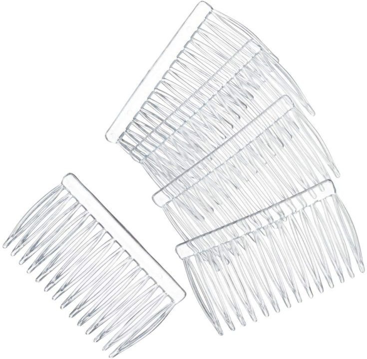 Transparent hair combs in a white background.
