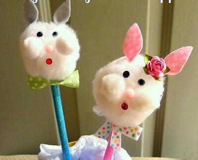 A fluffy bunny paintbrush topper on stick.