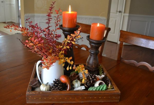 Pinecones, gourds and candles thanksgiving centerpiece