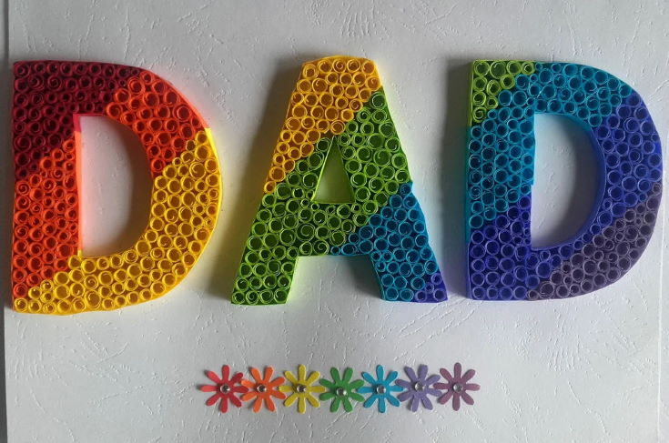 colorful word DAD in white background