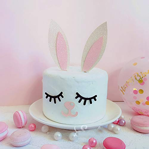 Cute bunny rabbit cake topper with a couple of food-safe bamboo sticks and some pink and white glitter cardstock