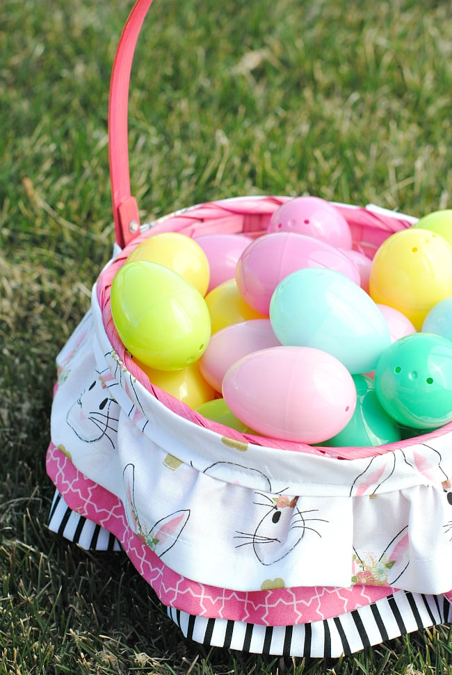 A traditional basket added a collar made from patterned fabric sewn into ruffled layers filled with colored plastic eggs.