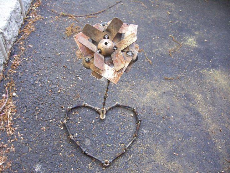DIY metalwork flower on the ground.