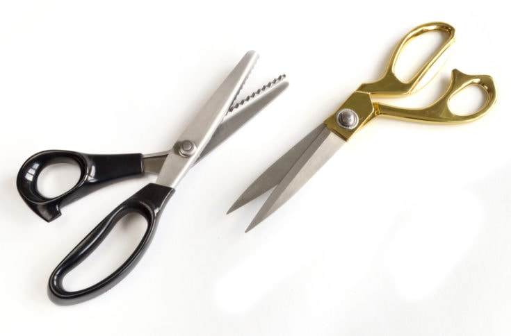 A pair of tailor's scissors isolated on a white background