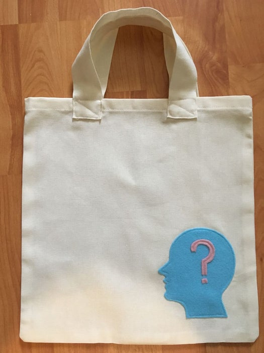 A simple beginner's bag with a blue head question mark design at the lower right portion of the bag