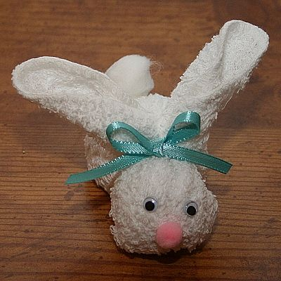 Adorable cute little rabbit project on a wooden background.