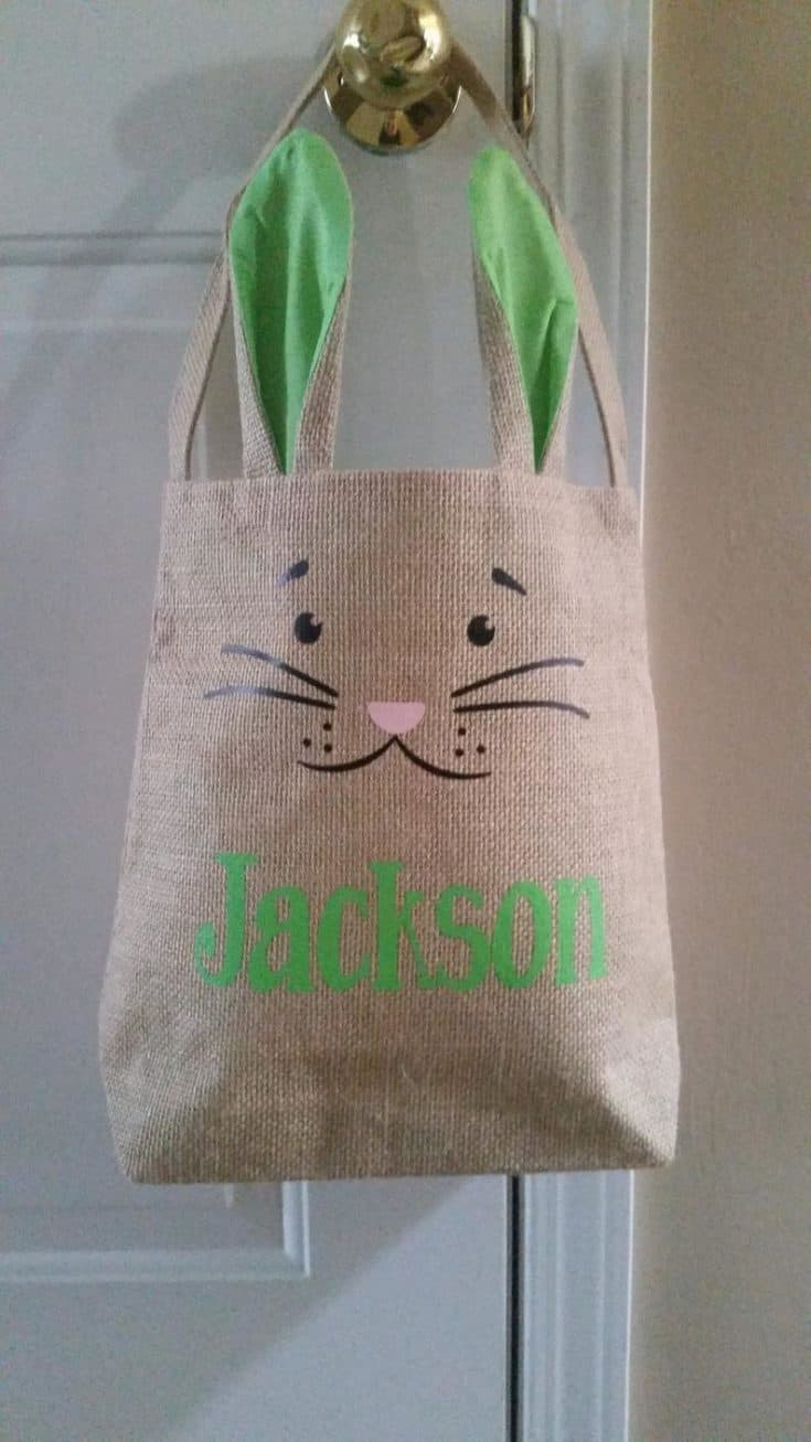 Heat transfer vinyl design added to the bunny design to the burlap bag.