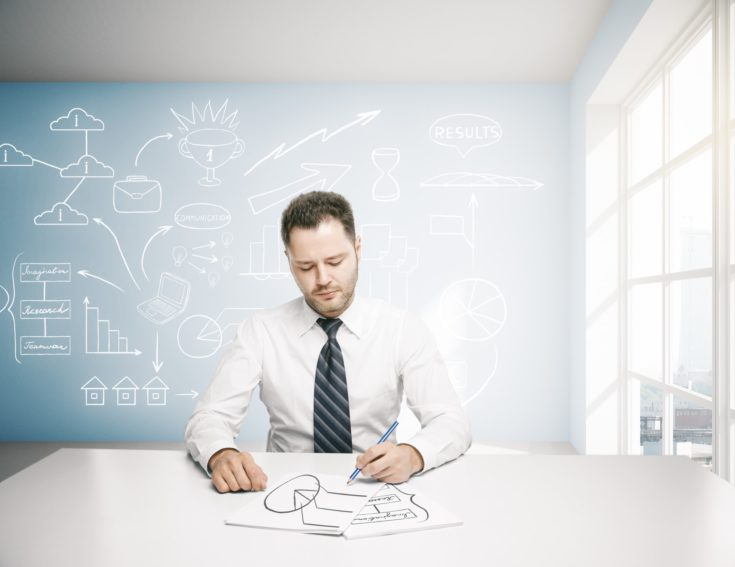 Businessman doing paperwork in bright office interior with business sketch on board
