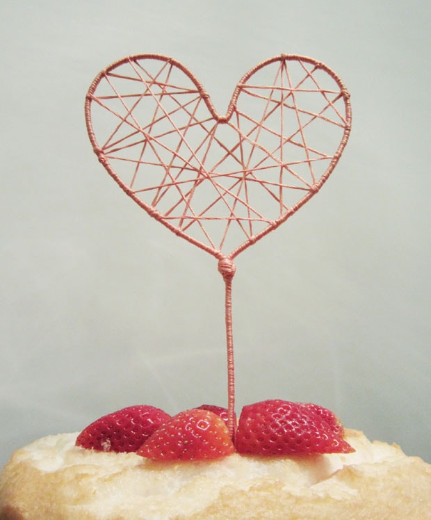 Heart-shape cake topper string art.