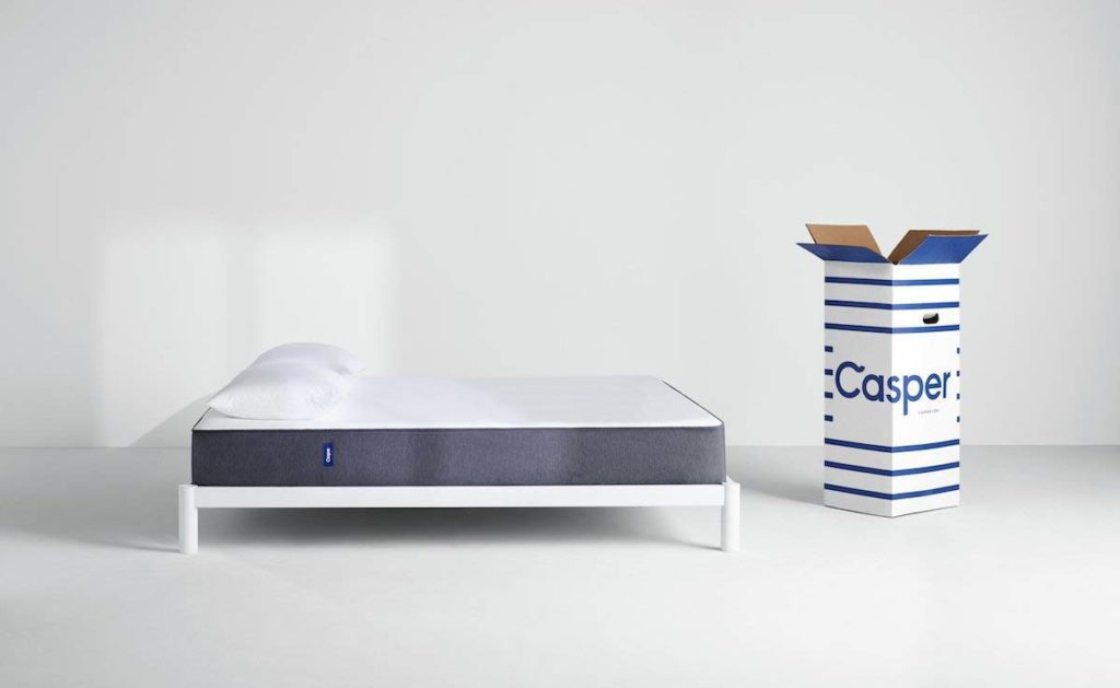 Casper memory foam with white pillow and an open casper box