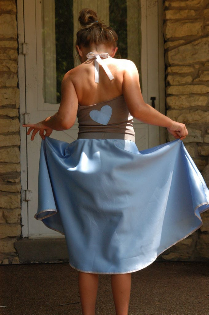 a girl wearing a powedered blue Circle Skirt, rear shot