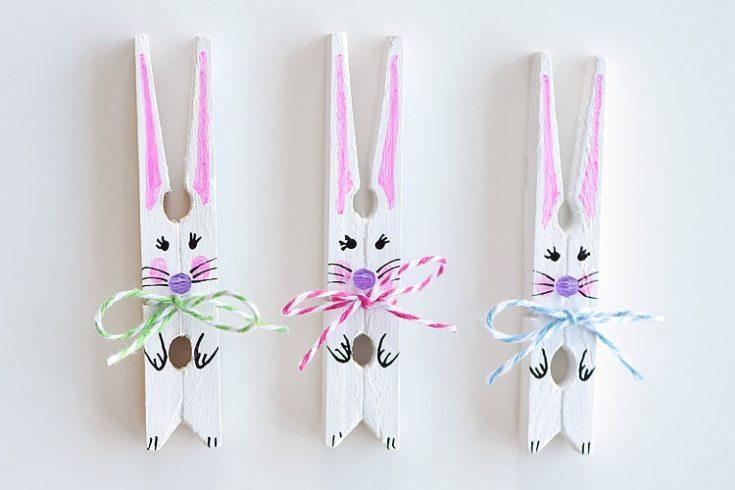 DIY clothespin bunnies in a whitebackground.
