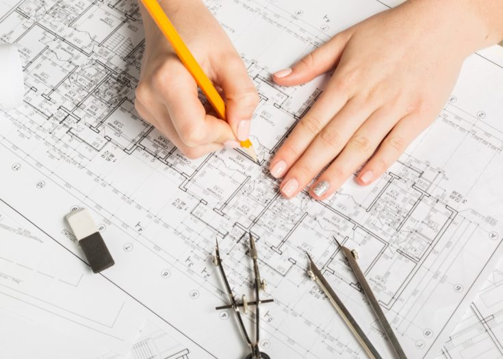 an architect sketching a detailed architecture plans
