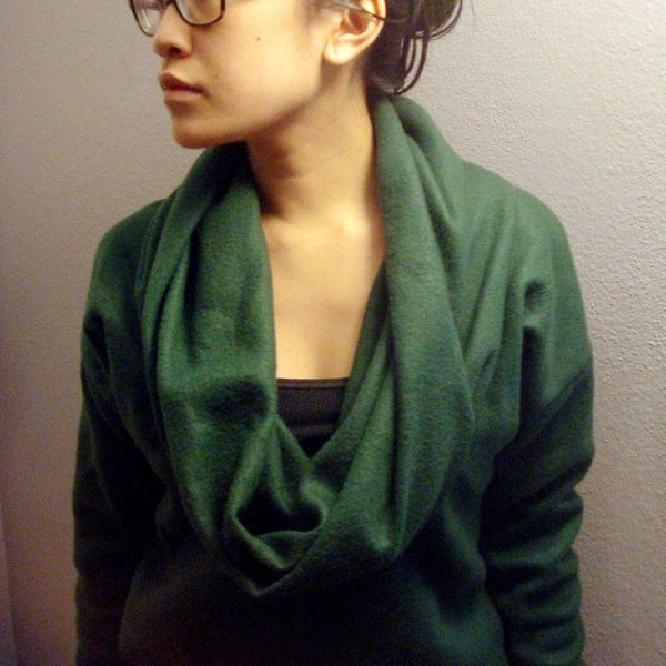Green Cowl-Neck Sweater From Fleece Blanket wore by a woman with eyeglass