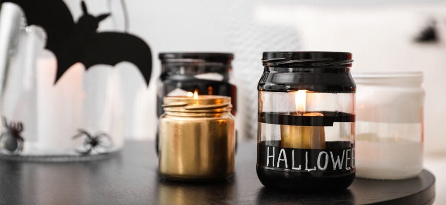 Jar painted in black and lighted tea candle for halloween craft.