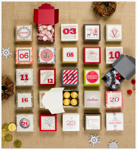 DIY boxes filled with chocolates and candies in brown cloth background