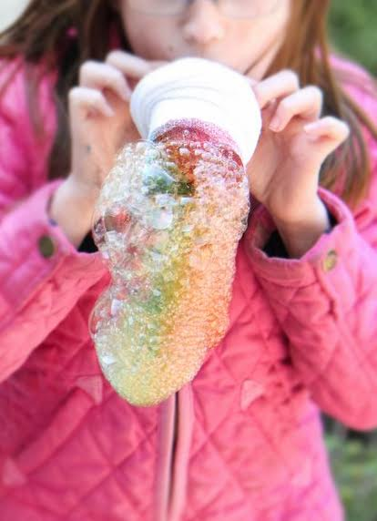 selective focus of DIY Bubble Snakes used by a young girl