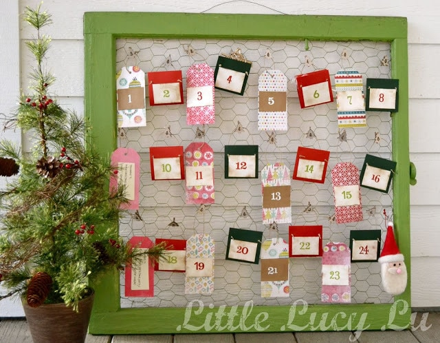 Country advent calendar in colorful envelopes hanged in wire in a green frame