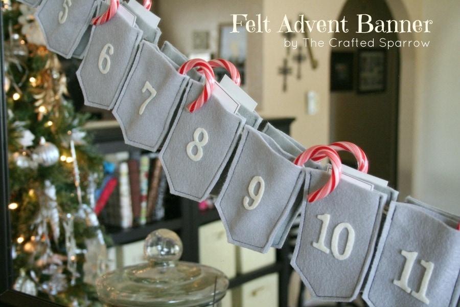 DIY banner gray numbered felt pouches with candy cane inside