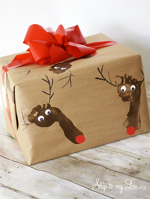 Brown wrapping paper with kid footprint and red ribbon by Skip to my Lou