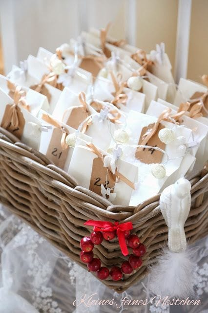 White paper bags tied with brown ribbon inside a wicker basket