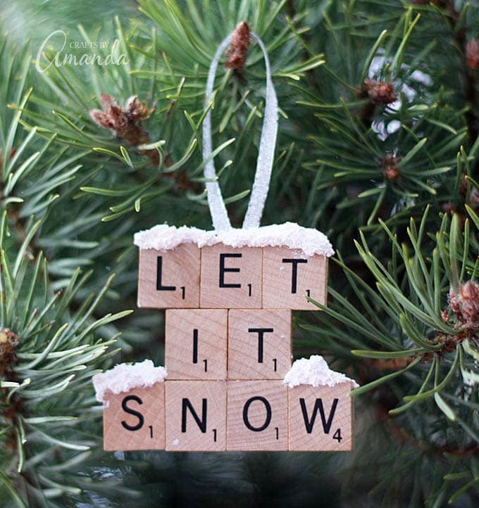 Let It Snow Spelled with Scrabble pieces ornaments with snow on it