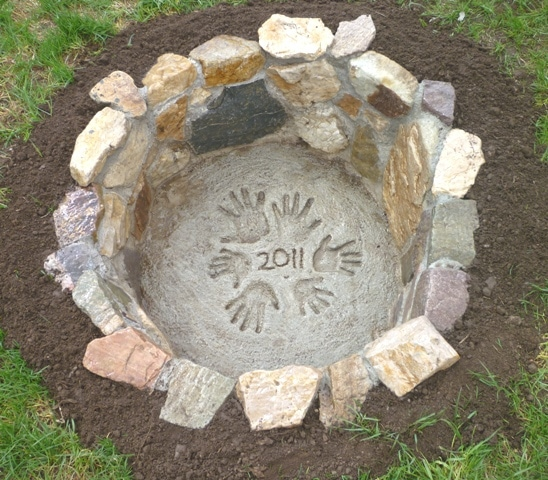 Stone Fire Pit with hand print and year