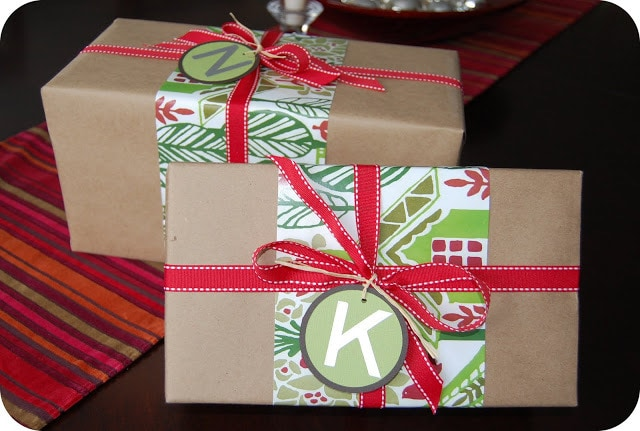 Monogrammed Christmas Gift Wrapper with red ribbon and letter tag