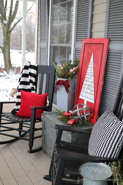 DIY outdoor Christmas sign with black porch chairs