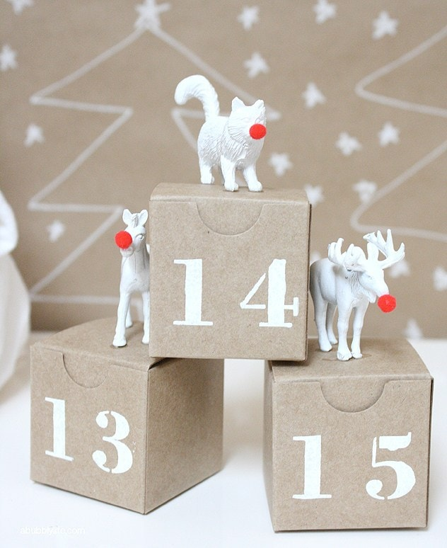 Printed with numbers brown cardboard boxes with animals figurine on top