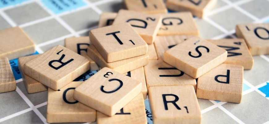 Scrabbles on top of a board.