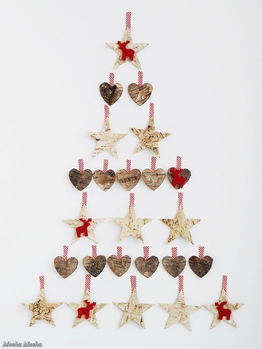 Heart and Stars form as Christmas tree on a white wall