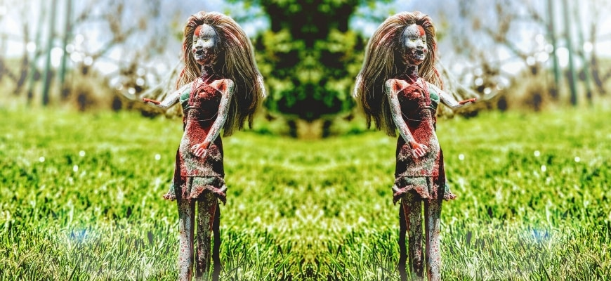 Walking Dead Doll Displayed on lawn grass