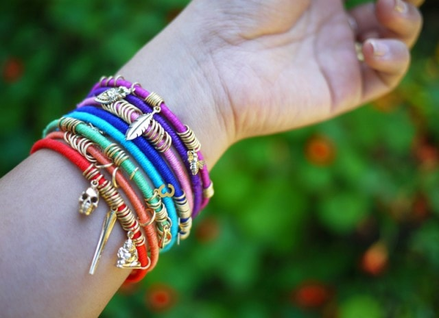a close up shot of a woman's wrist wearing a DIY Wrap Bangles