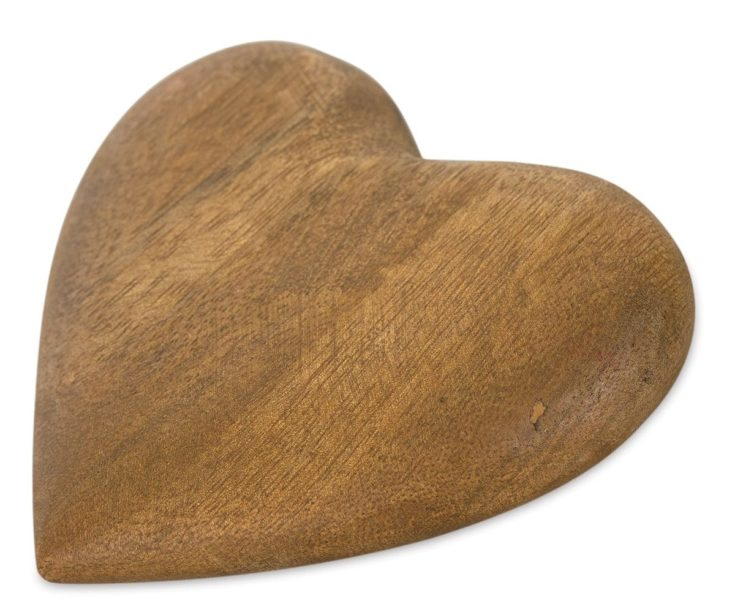 Heartshaped wood polish and ready to be use for any woodburning and engraving design in a white background.
