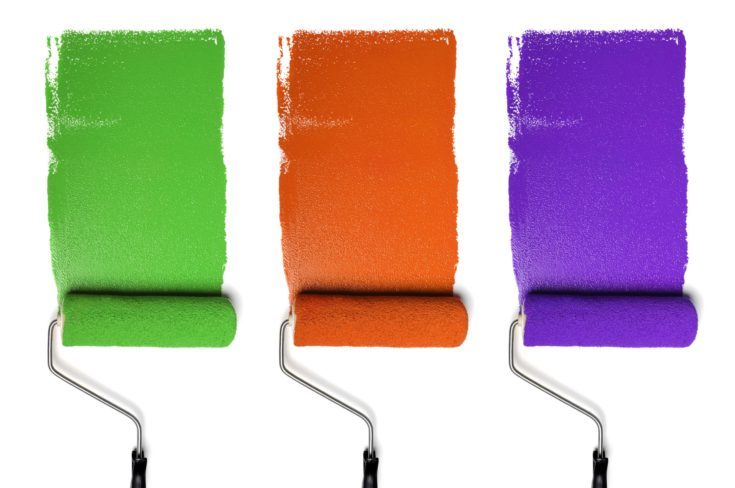 Paint Rollers with secondary colors isolated over white background